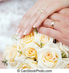 Hands with  bouque - Hands with wedding rings and bouquet