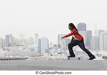 Teen Boy on Skateboard - African American Teen Boy on...