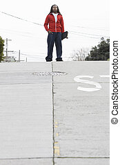 Teen Boy Standing with Skateboard - African American Teen...