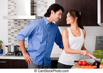 young couple in the kitchen - Beautiful young couple in the...
