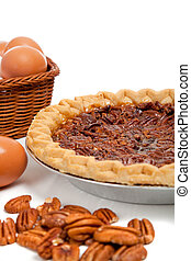 Pecan pie with ingredients on a white background