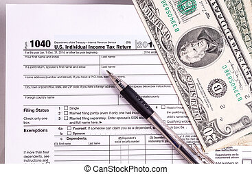 Tax form and Money. Filling the forms and hoping for a tax...