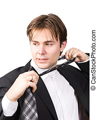 Tired businessman taking off his tie. Isolated on white.