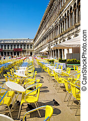Restaurant tables on Venice San Marco square.