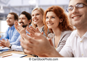 Ovations - Group of business partners applauding at...