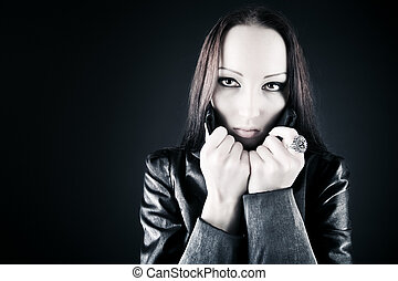 Goth woman portrait On dark background
