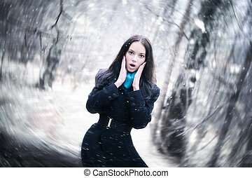 Young woman in a snowstorm Background blur effect