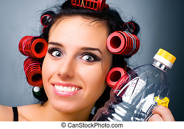 Young housewife with hair rollers and bottle.