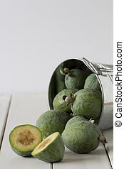 Feijoas in a Silver Bucket Tipped Over on a White Wooden...