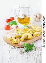 Tortellini - Homemade raw Italian tortellini and basil...