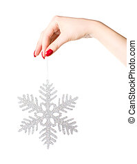Woman hand holding big holiday snowflake. Isolated on white.