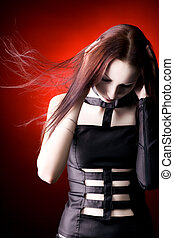 Goth woman with fluttering hair. Shallow dof.