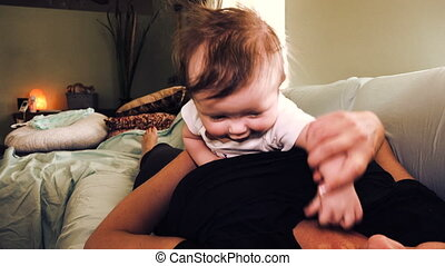 Baby Held Grabbing At Necklace - Watch out for wearing a...