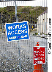 signs on the boundary fence of a building site in Ireland