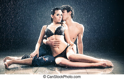 Young sexy couple. Water studio photo.