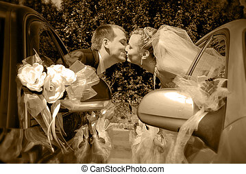 Wedding - Passionate married couple kissing with car windows...