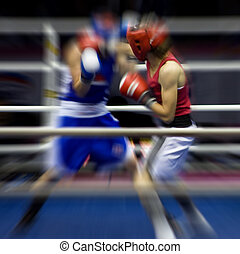 Boxing on a ring - Two sportsmen boxing on a ring