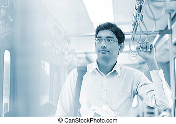 Man taking public transport - Asian Indian man taking public...