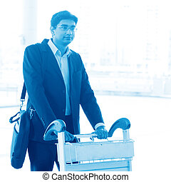 Man walking with airport trolley
