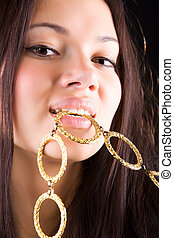 Young woman with colden chain