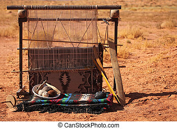 Blanket Loom - A blanket loom in the desert. No one is...