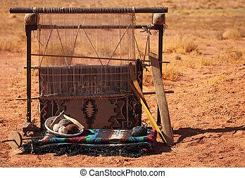 Blanket Loom - A blanket loom in the desert. No one is...