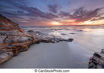 Dawn skies at Plantation Point Jervis Bay Australia -...