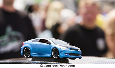 Toy Model Of Modern Car - Close-up footage with focus on a...