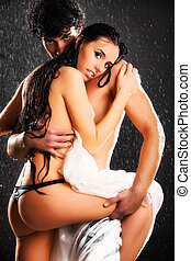 Young sexy couple Water studio photo