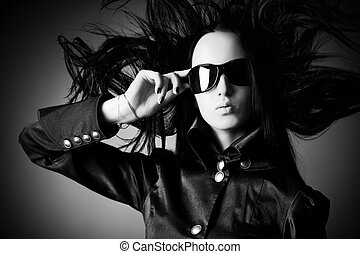 Goth woman with fluttering hair Black and white concept