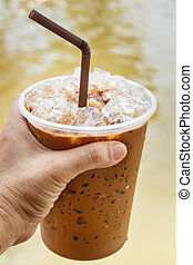 Iced Coffee. - iced coffee with straw in plastic cup.