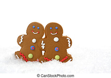 Gingerbread Cookies - Two gingerbread cookies in snow. There...