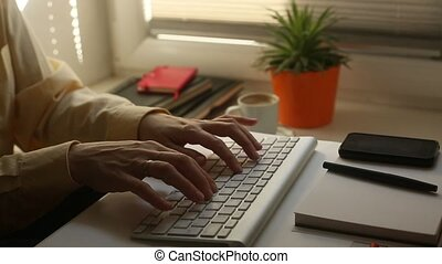 Female typing on computer keyboard - Female office worker...