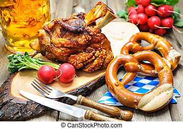 Oktoberfest - Roasted pork knuckle with pretzels and beer....
