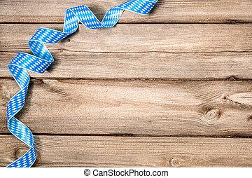 Background for Oktoberfest - Bavarian ribbon on wooden...