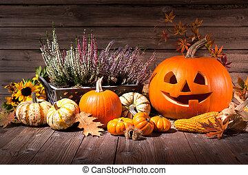 Autumn still life with Halloween pumpkins on old wooden...