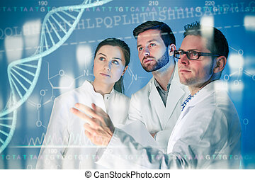 Genetic engineering - Group of geneticists working at media...