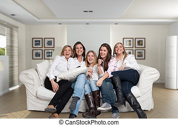 Female family fun - A group of five happy women of different...