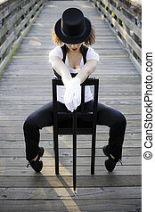 Jazz dancer Sitting on Chair - Jazz Dancer with Head Down...