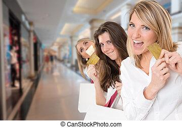 Girls shopping - Three young women in a happy shopping...