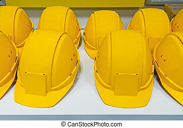 Helmets - Yellow protecting hard hats on bench ready for...