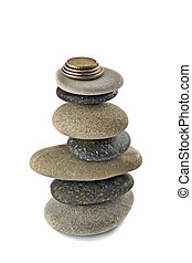 Stability, wealth and welfare - stone stack with coins -...