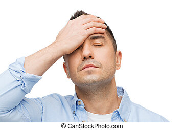 unhappy man with closed eyes touching his forehead - stress,...