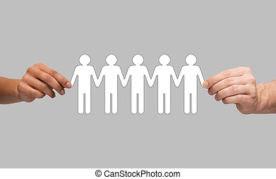 hands holding paper chain people - community, unity and...