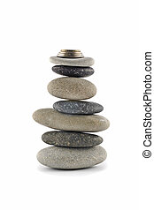 Welfare and Stability  - Balanced stone stack with coins