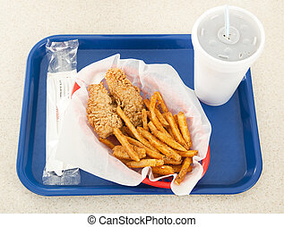 Fast Food - Fast food tray holding a basket of fried...