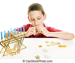 Eating Hanukkah Gelt - Little boy playing with his dreidel...