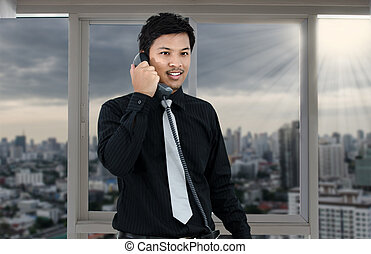 Business man talking telephone