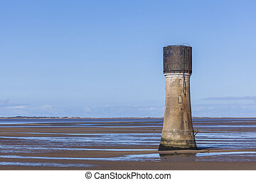 Concrete tower construction on Spurn Point Beach UK -...
