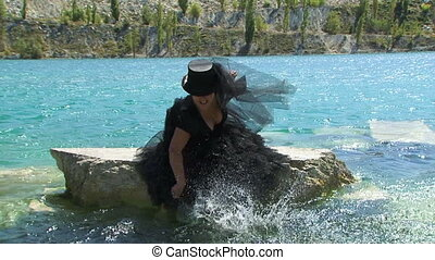 Woman In Black Splashing Water  on the  Lake